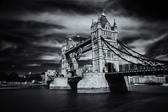 The Two Towers (Skuggzi) Tags: city uk travel bridge england blackandwhite bw london heritage history tourism monochrome metal stone thames architecture river symbol unitedkingdom steel tourist rings olympic iconic cultural