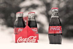 Coca Cola ~ The Real Thing... (Tina M89) Tags: winter snow bokeh cocacola sixpack glassbottles selectivecolour therealthing hcs hbw bokehlicious