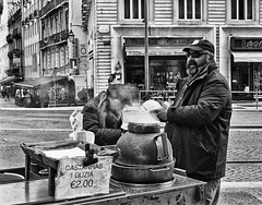 Selling baked chestnuts on Lisbon streets (antonioVi (Antonio Vidigal)) Tags: leica portugal 50mm lisboa lisbon summicron chestnuts f2 baixa m6 baked leicam6 restauradores castanhas assadas antoniovidigal antoniovi castanhasassadas