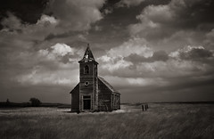 this sorrowful life (Rodney Harvey) Tags: blackandwhite abandoned church sepia rural town montana sad decay ghost dramatic infrared bleak weathered prairie plains desolate sorrow pioneer