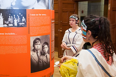 Inuit youth read information contained in the Legacy of Hope Foundations exhibit. (Aboriginal Affairs and Northern Development Canada) Tags: canada window students photo artwork culture parliament stainedglass firstnations apology inuit reconciliation houseofcommons mtis centreblock aboriginalpeoples indianresidentialschools legacyofhope aandc aboriginalaffairsandnortherndevelopmentcanada 100yearsofloss