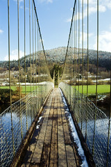 Suspension Bridge in Betws-y-Coed (Saturated Imagery) Tags: bridge snow film wales 35mm river slidefilm betwsycoed e6 conwy canoneos300 kodakektachrome100g