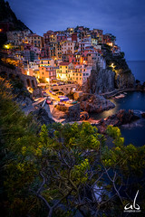 Manarola at Twlight || Cinque Terre, Italy (anoopbrar) Tags: italy cinqueterre cinque terre seaside town twilight bluehour city nightlife longexposure photography amalficoast manarola explore beautiful artistic art hillside hills citylights landscape blue hour ocean building skyline downtown sunset sunrise landscapephotography cities nature outdoor night long exposure reflections foreground dusk architecture buildings urban seascapes travel travelphotography water