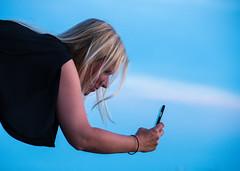 Taking a picture (Maria Eklind) Tags: sunlight sunset nature city vstrahamnen trdcket sun summer siluett malm boardwalk vatten sundspromenaden solnedgng goodnightsun silhouette europe sky sweden skneln sverige se