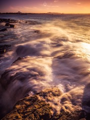 Spilling Over (Augmented Reality Images (Getty Contributor)) Tags: australia canon landscape leefilters light longexposure nationalpark noosa queensland rocks seaside sunset sunshine water waves