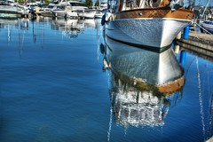 Bow Reflections (zenseas : )) Tags: dance dancing reflect reflected reflections sails sailboats sailboat boat boats water dock harbor pier fishermansterminal seattle washington sunny summer bow yacht portofseattle salmonbay