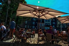 drinks time on the terrace of Le Maison Bleu under parasols in blazing summer afternoon sun, Honfleur, Normandy, France (grumpybaldprof) Tags: vieuxbassin oldharbour honfleur normandie normandy france quaistecatherine quaiquarantaine quai quaistetienne stecatherine lalieutenance quarantaine water boats sails ships harbour historic old ancient monument picturesque restaurants bars town port colour lights reflection architecture buildings mooring sailing stone collombage halftimbered yachts ruemontpensier shops touristshops souveniershops maisonbleu hdr sun sunshine sky blazing summer drink drinks terrace leisure holiday vacation restaurant brasserie bar parasol colours shade contrast brilliant shadow detail