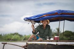 Old man on his boat on the Mekong River (leonardrodriguez) Tags: vietnam people visage portrait vietnamese vietnamien vietnamienne vietnamiens vietnamiti vietnamita asie asia mekong river oldman old man boat bateau delta