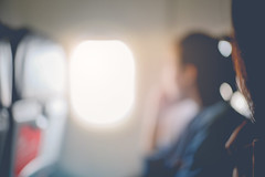 Abstract blur of woman looks out the window of an flying airplane. vintage filter effect (Natee Meepian) Tags: abstract air aircraft airline airplane alone arm armrest arrival arrive asian background black bokeh business color dark defocused depart departure dream flight fly girl holiday landing ocean office passenger people person plane seat shadow sit space summer takeoff tourism tourist transportation travel trip urban vacation vehicle watch white window woman