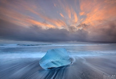 Ice on Fire (orvaratli) Tags: ocean blue seascape cold ice beach water berg sunrise landscape lava photo iceland sand wave arctic