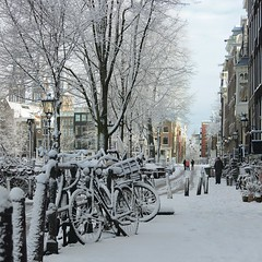 Winter came down in Amsterdam gentle and kind (Bn) Tags: world street trees windows winter light sunset people sun seagulls house snow cold holland heritage church water netherlands dutch amsterdam weather bike corner walking frank anne boat canal cozy cool topf50 colorful shadows jan snowy walk sneeuw bikes atmosphere scooter file canals unesco brug snowfall sled mokum rembrandt meeuw meeuwen gezellig cafs keizersgracht jordaan sleding bycicle posthoornkerk westertoren brouwersgracht nowandthen pakhuis lange westerkerk celcius annefrankhuis grachtengordel rondvaartboot 1000km 50faves 1c lekkersluis onzelievevrouweonbevlektontvangen
