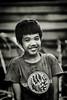 Laotian Boy (violinconcertono3) Tags: boy portrait blackandwhite smile young laos mekong davidhenderson londonphotographer 19sixty3