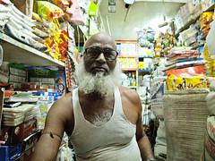 Muji Chacha (azkin) Tags: people man glasses small shops dhaka bangladesh tunktop
