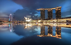 The Lion City (TheFella) Tags: city travel blue sky urban reflection slr water skyline museum architecture clouds digital skyscraper photoshop sunrise canon buildings eos dawn lights bay photo flyer singapore asia southeastasia cityscape skyscrapers cloudy harbour capital smooth landmark resort photograph blended processing 5d bluehour dslr hdr highdynamicrange urbanlandscape mkii blending markii postprocessing citystate travelphotography photomatix artscience lioncity republiksingapura singaporeflyer marinabaysands thefella 5dmarkii conormacneill marinabaysandshotel thefellaphotography replublicofsingapore
