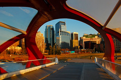 Downtown Calgary from the Peace Bridge (LostMyHeadache: Absolutely Free *) Tags: winter sunset urban snow calgary nature grass architecture canon buildings river spring downtown path magichour santiagocalatrava peacebridge davidsmith calgaryalbertacanada eos60d
