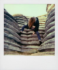 Climb. (-MRGT) Tags: sun paris film girl rock analog vintage hair polaroid climb weird legs grain hidden instant pola foutain instantphotography supercolor polaroid635 mrgt impossibleproject px680 colorprotection margotgabel