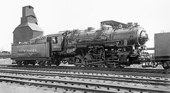 New Haven Railroad coal burning steam switcher # 3601, built by ALCO in 1924, NH class Y-4 (3-cylinder) 0-8-0, is seen at an unknown railroad yard location, mid 1930's, photographer unknown (alcomike43) Tags: old railroad blackandwhite bw classic yard vintage ties photo tracks engine trains scan historic steam photograph rails newhaven locomotive freighttrains coal spikes tender steamengine coalingtower ballast 1924 rightofway steamlocomotive alco railroadyard passengertrains 080 roadbed coaltipple 3601 newhavenrailroad 3cylinder nynhh tieplates anglebars conventionaljointedsectionrails y4class