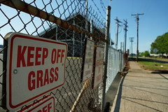 Stay off the green (SkateLifeLLC) Tags: signs color grass shadows power gates fences sidewalk shreveport slta77v