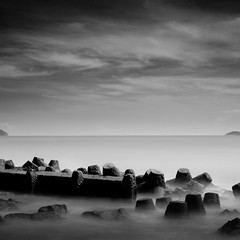 Barriers Between Us (Quincy Jefferson) Tags: longexposure sea water monochrome vietnam tetrapods nd110