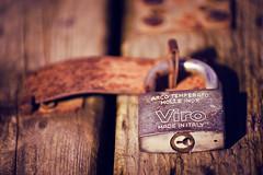 Key Light (Prestidigitizer) Tags: pentaxk3 pentaxda50135mm lock padlock hasp locked wood antique worn weathered rust steel dilapidated italy stainlesssteel