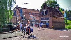 The fire engine house, IJsselstein, Netherlands - 4330 (HereIsTom) Tags: webshots travel europe netherlands holland dutch view nederland views you sony cybershot hx9v nature sun tourists cycle vakantie fietsvakantie cycling holiday bike bicycle fietsen brand fire house engine ijsselstein brandweer brandspuithuisje canal brug groene street city utrecht town buildings village
