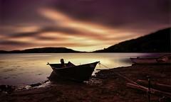 - t e r r a m a d r e - (swaily ◘ Claudio Parente) Tags: lago lagodicampotosto sunset tramonti tramonto lake barca barche laquilaabruzzonikon d300 swaily claudioparente