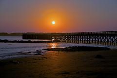 Sunset Romance (SunnyDazzled) Tags: ocean sunset sky sun beach reflections coast pier colorful waves maine silhouettes romance fortfoster