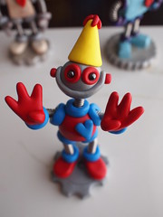 Work in Progress: Robot 6th Birthday Cake Topper (HerArtSheLoves) Tags: birthday blue red cute smiling yellow cake work silver happy robot heart candid adorable posing progress gear mini sixth topper geeky 6th fingersup herartsheloves theawesomerobotscom