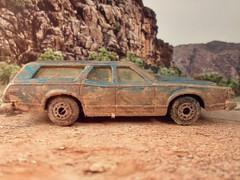 Knackered Mercury (HrExplorer) Tags: road trip blue cars car station wagon drive long desert mud mercury weathered cougar muddy matchbox villager