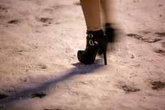 Aussie in the Snow (Andrew R. Whalley) Tags: shadow snow motion blur cold feet ice girl tattoo lady evening shoes highheels republic czech prague boots australian kangaroo heels aussie ankles