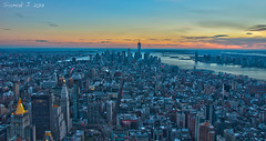 The Sun Sets over Manhattan (Haf3z) Tags: city bridge light sunset urban usa newyork rooftop water skyline architecture brooklyn night clouds skyscraper river lights evening march nikon wasser skyscrapers rooftops traffic manhattan horizon himmel hudsonriver empirestatebuilding hudson bluehour theunitedstatesofamerica brcke acqua vatten hdr solnedgng urbanphotography longtimeexposure thebigapple  leau d90 lacqua   2013 18105mm skyskrapor nikond90  nikkor18105mm hdraward silveramazingdetails