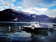 Annecy fishing boat (Zilch^^) Tags: blue lake france alps annecy boat fisherman buoy buoyant