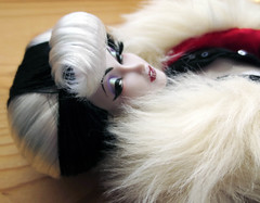 Cunning (Enchanticals) Tags: red portrait white black female fur glamour doll soft dolls eyelashes deception disney faux bangs villain cruelladevil vain eyeliner lyingdown prone cruella lavish onesixthscale twotonehair chiseledfeatures disneyvillian enchanticals minitreasures displaydoll enchanticalsetsy villaincollectibledoll