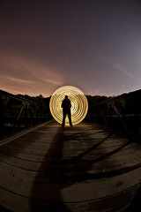Spinning ([Nocturne]) Tags: nightphotography bridge blue portrait lightpainting yellow night clouds canon stars lowlight colours go spinning leds local nocturne spinner longexposures solhouette lowlightphotography lpp noctography 5dmkii wwwnoctographycouk