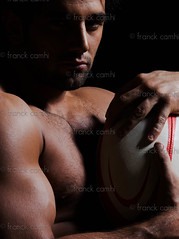 sexy topless rugby man portrait (Franck Camhi) Tags: shadow portrait white playing man france detail sexy male sports face muscles closeup blackbackground cutout person one 1 hugging glamour holding focus adult affection serious rugby muscular young handsome headshot player arrogant indoors attitude thinking topless strong strength studioshot sensuality embrace macho powerful isolated arrogance caucasian toughness rugbyball lookingatcamera