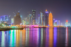 Doha Corniche (Helminadia Ranford) Tags: city light reflection building colors night cityscape clear arab gcc doha qatar