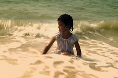 pure joy cannot be bought or sold (~mimo~) Tags: ocean trip travel blur color wet water girl smile shirt happy photography asia waves sitting child candid joy stranger malaysia penang mimokhair