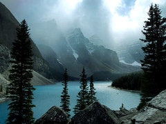 The Clouds Burst (UponInfinity) Tags: blue trees sky mist lake canada mountains tourism fog pine clouds forest rocks rocky alberta flare jagged banff moraine