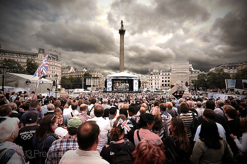 Crowds Mass in Trafalgar Square to watch Athletes on a Large Video Screen
