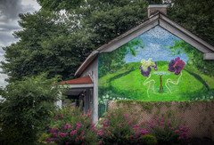 So, an Iris and a Pansy were sitting at a table and one of them says... (donnieking1811) Tags: tennessee nashville architecture buildings building restaurants restaurant cafes cafe porches porch murals mural flowers canon colorful