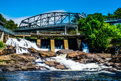 Bracebridge Falls, Ontario, Canada (DDB Photography) Tags: waterfall waterfalls dam bridge bracebridge ontario canada rocks bay river falls landmark landscape serene peaceful trees blue sky lake muskoka cottage country outdoor outdoors harbourfront harbour scenic reflection waterway canal sun leaves photography photo ddbphotograhy ddbphotography sony a77m2 water building arch architecture