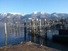 20160318_172331 (coldgazemedia) Tags: switzerland photobank stockphoto ticino locarno landscape lake lakemaggiore bluesky blue swissvillage snowmountain outdoor pier duck water waterfront sea seaside scenery mountain