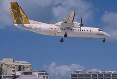 285ai - Caribbean Star Airlines DHC-8-311 Dash 8; V2-LGB@SXM;07.03.2004 (Aero Icarus) Tags: avion plane aircraft flugzeug slidescan princessjulianainternationalairport saintmartin sintmaarten sxm caribbeanstarairlines dhc8300 dash8 v2lgb