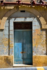 Doorway, Rabat, Malta (jeremyhughes) Tags: door architecture malta rabat doorway blue weathered peeling building feature city town street entrance entry frame doorframe nikon d750 nikkor 35mm 35mmf2d wroughtiron lightandshadow sunshine patina patinated decay