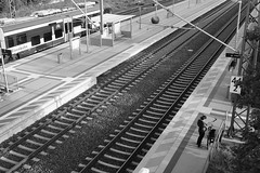 Waiting (JKLensman) Tags: bahnhof sw schwarzweis schienen fujixt2 fujinonxf2728 infrastruktur linien