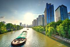 Grand Canal Hangzhou (Andy Brandl (PhotonMix.com)) Tags: china hangzhou grandcanal ships above modern river channel water transportation highrises hdr nikon photonmix zhejiang sky sun cityscape