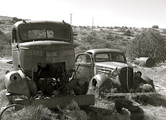 rusted chevrolet car & navy truck (redrock flyer) Tags: arizona bw chevrolet blackwhite rust desert rusty rusted oldcar cabover oldwreck cordesjunction cabovertruck caboverengine navytruck 1936chevroletauto