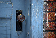 Textures (she who is) Tags: door wood blue red summer black calgary yellow evening peeling alleyway alberta whit knob keyhole brass brickpaint