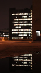 Reflection (_DanBaird) Tags: new city uk trip england sky orange brown white man black blur color colour reflection brick window beautiful rock metal stone night speed canon reflections dark point manchester puddle photography eos lights stand photo interestingness focus europe exposure pretty colours dof view shot angle bokeh pov bricks piccadilly ground depthoffield pointofview journey citylights shutter prettylights popular potrait rectangle apature shutterspeed picoftheday durt colurs machester 600d outstandingshots outstandingshot canon600d eos600d