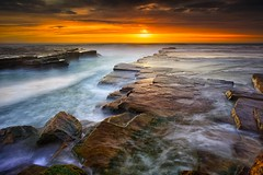 Sea Of Gold (Noval N | Photography) Tags: longexposure morning seascape nature clouds sunrise landscape rocks sydney australia